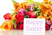 Bunch of tulips with card: happy easter — Stock Photo