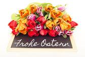 Bunch of tulips with blackboard: happy easter — Stock Photo