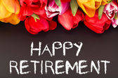 Bunch of tulips with blackboard: happy retirement — Stock Photo