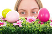 Girl finding some easter eggs — Stock Photo
