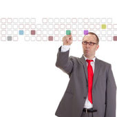Businessman taping on some buttons — Stock Photo