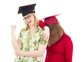 Two female graduates — Stock Photo