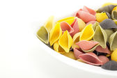 Uncooked and colorful italian noodles — Stock Photo