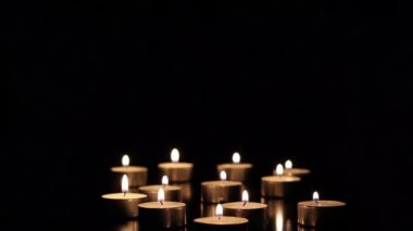 Burning candles on a dark background — Stok video