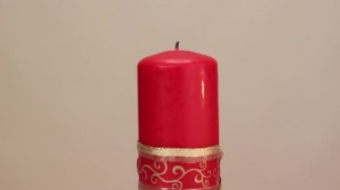 Burning candle on a light background — Стоковое видео