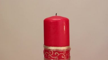 Burning candle on a light background — 图库视频影像