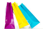 Algunas bolsas coloridas sobre fondo blanco — Foto de Stock