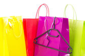 Colorful shopping bags with black clothes hanger — Stock Photo