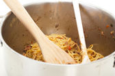 Cooking spaghetti bolognese for dinner — Stock Photo