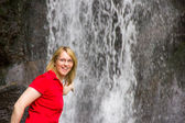 Beautiful caucasian woman in front of the waterfall — Stock Photo