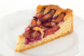 Slice of cake with sweet plums — Stock Photo