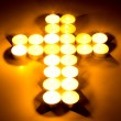 Christian cross made with tea candles — Stock Photo