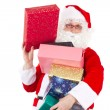 Santa Claus with lot of beautiful gifts — Stock Photo