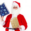 Santa Claus carrying two gifts — Stock Photo