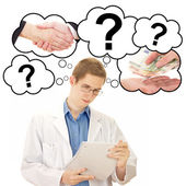 Young man thinking about his job as medical doctor — Stock Photo