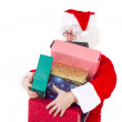 Santa Claus carrying too much colourful gifts — Stock Photo #37573171