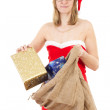 Mrs. Claus with jute bag spreading gifts to all nice children — Stock Photo