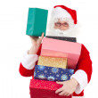 Santa Claus spreading lot of gifts to nice children — Stock Photo #37573347
