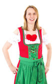 Blond woman in red dirndl waiting for her valentine — Stock Photo