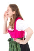 Beautiful woman in dirndl talking in vain — Stock Photo