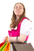Young woman in dirndl addicted to shopping — ストック写真