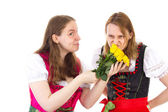 Beautiful mother thinks that these yellow roses stink — Stock Photo