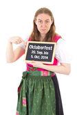 Girl in dirndl shows period of Oktoberfest 2014 on chalkboard — Stock Photo