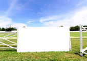 Blank billboard against blue sky, put your own text here — Stock Photo
