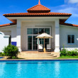 Dream house with pool in sunny day - Stock Photo