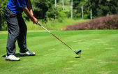 Player hit golf Stick and Ball on the Green Grass — Stock Photo