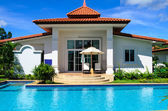 Dream house with pool in sunny day — Stock Photo