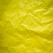 Yellow Crumpled paper background vignette — Stockfoto