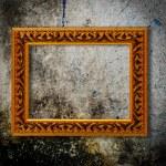 Retro wooden frame over grunge wallpaper — Stock Photo