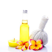 Herbal compress ball and massage oil for spa treatment — Stock Photo