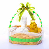 Gift set of herbal compress ball and massage oil for spa treatme — Stock Photo
