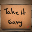 Stock Photo: Take it easy on paper and wooden wall