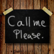 Please call me note on message note with wooden background — Stock Photo