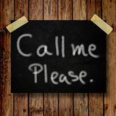 Please call me note on message note with wooden background — Foto Stock