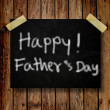 Stock Photo: Happy Father Day note on message note with wooden background