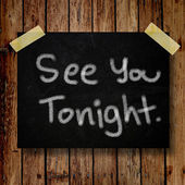 See you tonight note on message note with wooden background — Stock Photo
