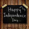 4th of July independence day note paper with wooden background — ストック写真