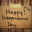4th of July independence day note paper with wooden background — Stock Photo
