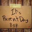 Happy parent day on note paper with wooden background — Stock Photo #27423097
