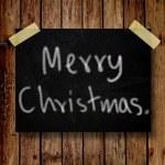 木製の背景を持つメッセージ メモにメリー クリスマス — ストック写真
