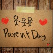 Happy parent day on note paper with wooden background — Stock Photo