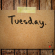 Tuesday on note paper with wooden background — Stock Photo