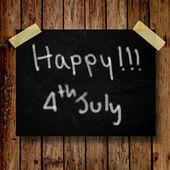 4 juli onafhankelijkheid dag opmerking paperwith houten achtergrond — Stockfoto