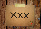Note paper and clothes peg on a wooden background with kiss mess — Stock Photo