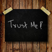 Trust me on message note with wooden background — Stock Photo