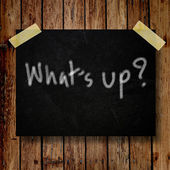What's up on message note with wooden background — Stock Photo